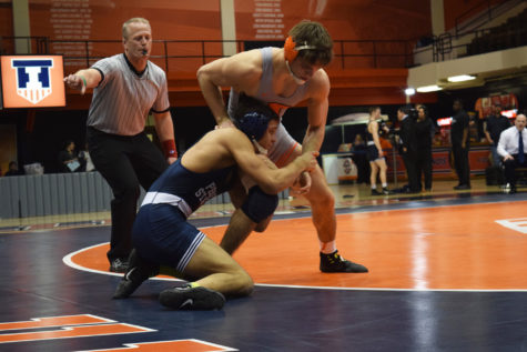 Illinois' Steven Rodrigues takes ahold Penn State's Shakur Rasheed during the wrestling match vs. Penn State at Huff Hall on Saturday January 23, 2016. The Illini lost 15-30.