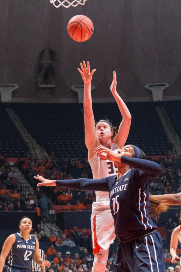 Illinois' Alex Wittinger takes a jump shot during the game against Penn State at the State Farm Center on January 23. The Illini lost 65-56.