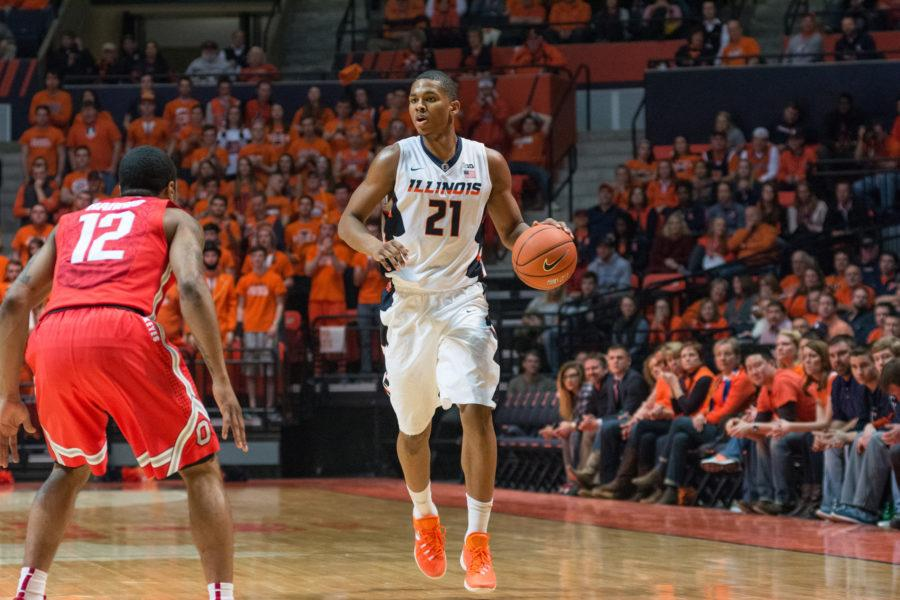 Illinois' Malcolm Hill brings the ball up the court during the game against Ohio State at the State Farm Center on Thursday, January 28. The Illini lost in overtime 68-63.