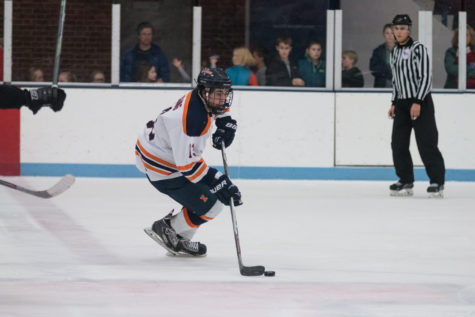 Illinois' James Mcging carries the puck up the ice during the game against Lindenwold University at the Ice Arena on Saturday, January 30. The Illini lost 4-1.