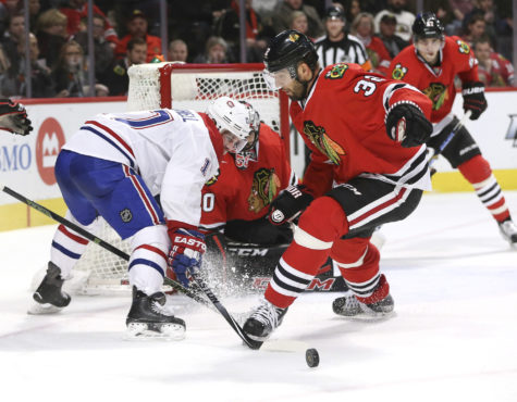 Chicago Blackhawks defenseman Michal Rozsival (32) gets the puck away from Montreal Canadiens center Torrey Mitchell (17) during the second period on Sunday, Jan. 17, 2016, at the United Center in Chicago. (Nuccio DiNuzzo/Chicago Tribune/TNS)