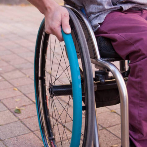 Pictured are examples of IntelliWheels's product Fit Grips, which make moving around more comfortable and easier for wheelchair users. Through IntelliWheels's website, people can customize the size and color their products.