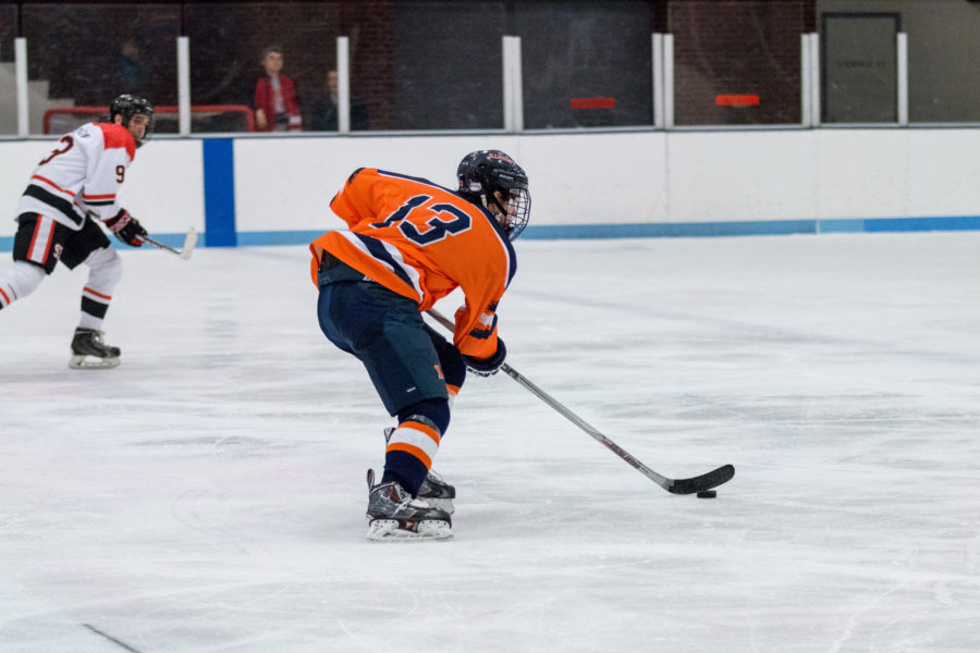 James McGing carries the puck down the ice during the game against Illinois State at the Ice Arena on February 12. The Illini won 5-2.