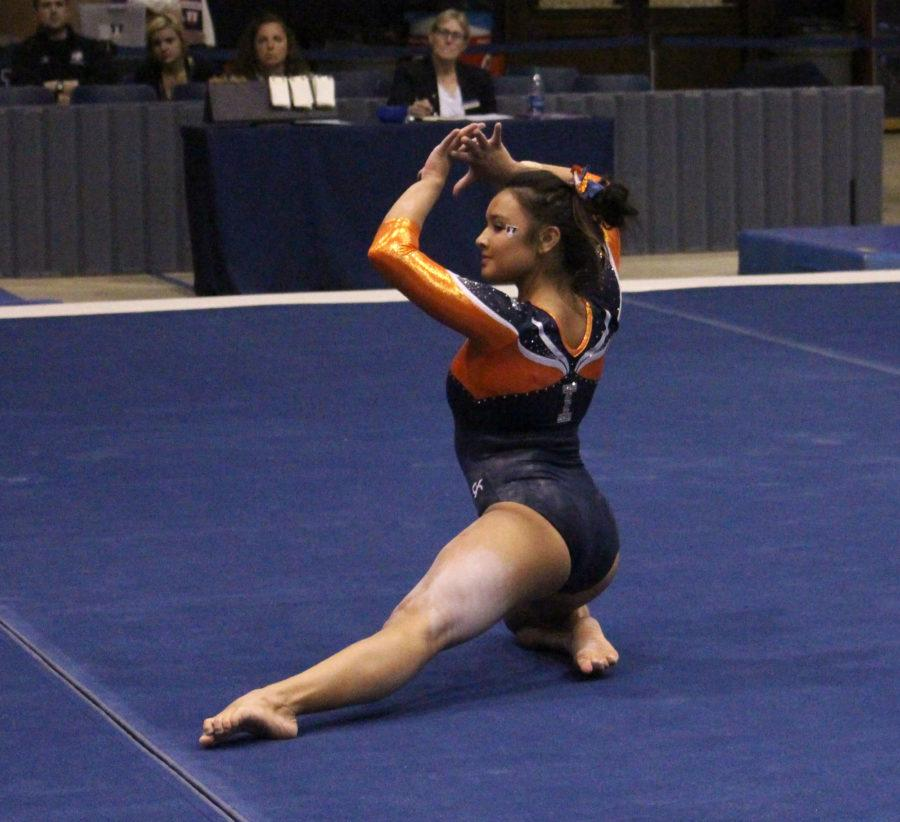 Lizzy LeDuc on the floor during the match against Michigan at Huff Hall on January 22, 2016. Michigan won 196.825 to 195.15.