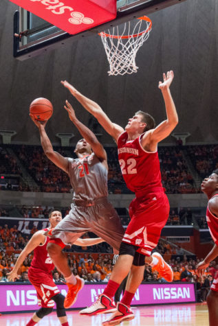 Illinois' Malcolm Hill shoots a layup over Wisconsin's Ethan Happ during the game against Wisconsin at the State Farm Center on Sunday, January 31. The Illini lost 63-55.
