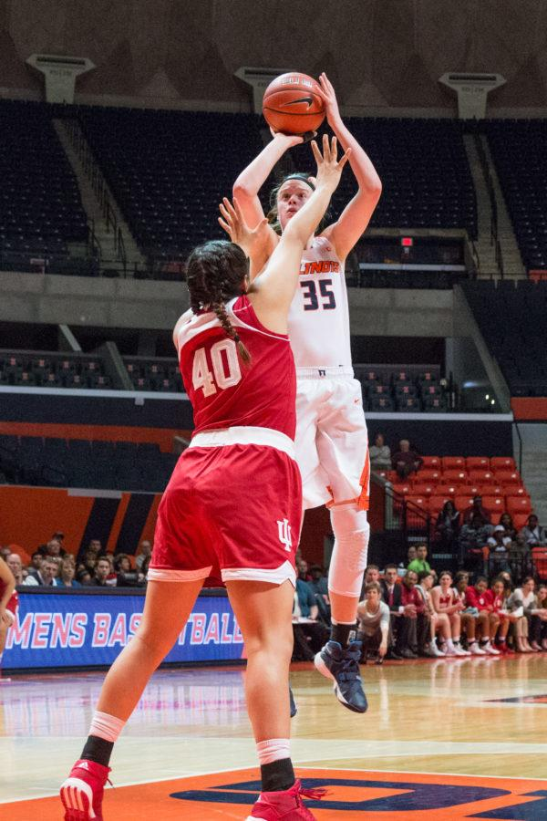 Illinois' Alex Wittinger shoots a jumper over Indiana's Lyndsay Leikem during the game against Indiana at the State Farm Center on Feb. 10. The Illini lost 70-68.