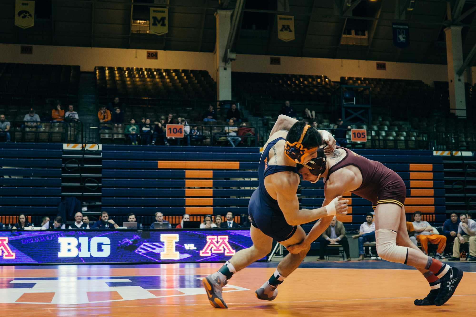 Illinois' Isaiah Martinez grapples against Minnesota's Brandon Kingsley in Huff Hall on Feb. 12 2016. The Illini won 19-16.