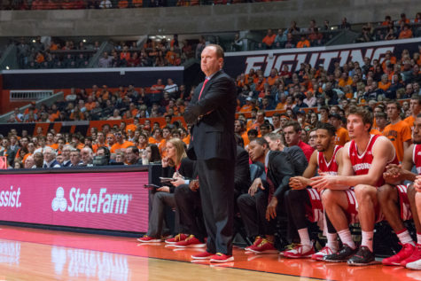 Wisoconsin's head coach Greg Gard watches his team from the sidelines during the game against Illinois at the State Farm Center on Sunday, January 31. The Illini lost 63-55.