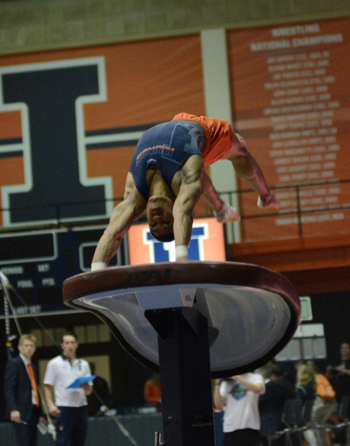 Illinois' Chandler Eggleston performs a vault routine during the meet against Temple & UIC at Huff Hall on Saturday, Feb. 6, 2016.