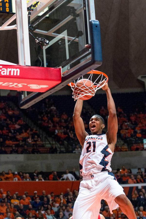 Malcolm Hill throws down a two handed dunk in the second half of Illinois' victory over Rutgers on Tuesday Night. Hill recorded his sixth double-double of the season Tuesday.