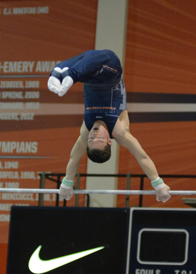 Illinois' Alex Diab performs a bar routine during the meet against Temple & UIC at Huff Hall on Saturday, Feb. 6, 2016.