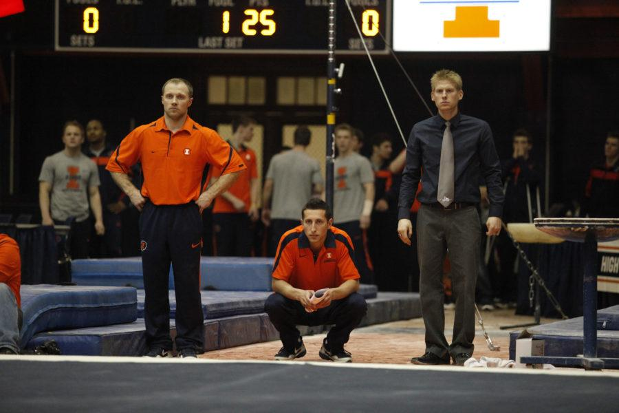 Daryl Quitalig The Daily IlliniIllinois head coach Justin Spring, right, watches ___ floor routine during the Gym Jam at the Huff Hall on Friday, March 2, 2012.