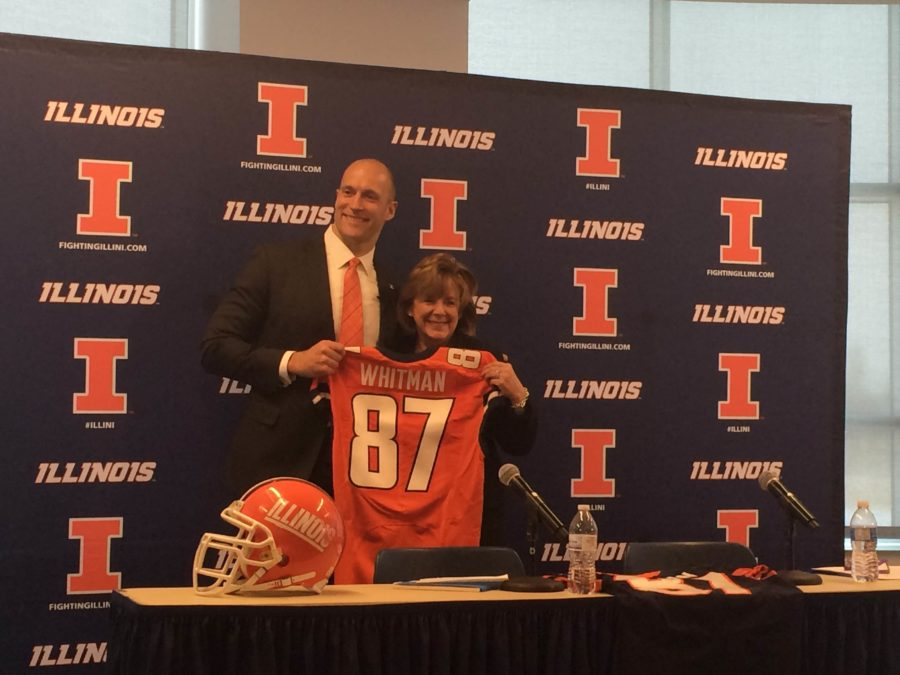 Illinois newathletic director Josh Whitmanand Interim Chancellor Barbara Wilson pose for photos after an introductory press conference announcing Whitman as the next Illinois athletic director.