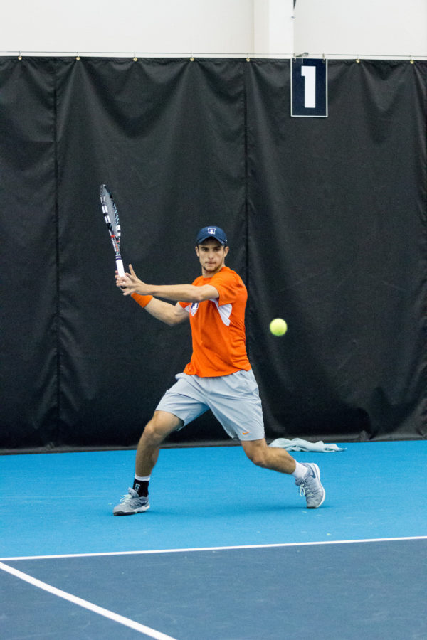 Illinois' Aleks Vukic gets ready to return the ball during the match against Notre Dame at the Atkins Tennis Center on Friday, February 5. The Illini won 5-2.