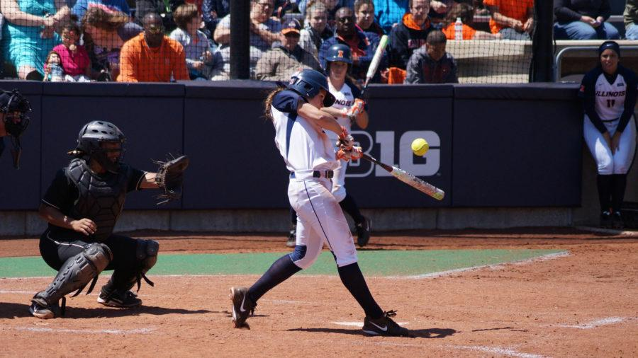 Illinois%27+Allie+Bauch+%2821%29+attempts+to+pop+up+the+ball+during+the+softball+game+v.+Purdue+at+Eichelberger+Field+on+Sunday%2C+Apr.+26%2C+2015.+Purdue+won+8-7.