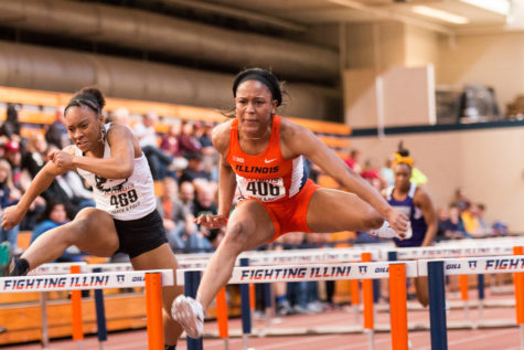 Illinois' Pedrya Seymour leaps over a hurdle during the Orange and Blue meet on Saturday, February 20, 2016. Pedrya won the 60 meter hurdles with a time of 8.27 seconds.