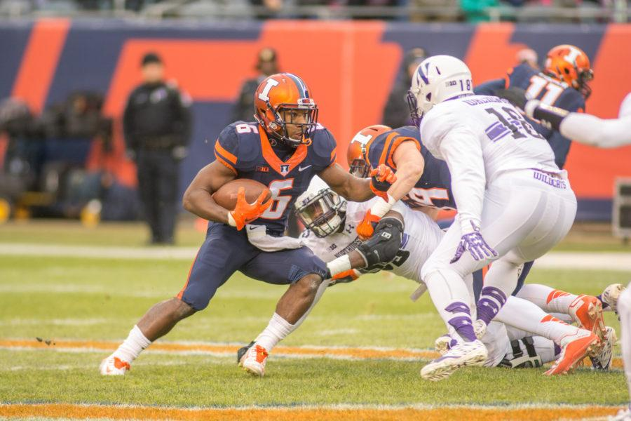 Running back Josh Ferguson makes a run during the game against Northwestern at Soldier Field on Saturday, Nov. 28. Illinois lost 24-14.