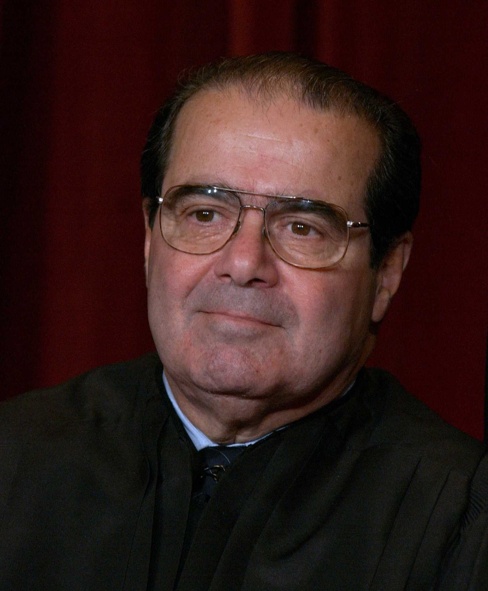 KRT US NEWS STAND ALONE PHOTO SLUGGED: SUPREMECOURT KRT PHOTOGRAPH BY PETE SOUZA/CHICAGO TRIBUNE (December 5) WASHINGTON, D.C.--  Supreme Court Justice Antonin Scalia, one of nine justices of the Supreme Court who posed for news photographers in a rare session Friday, December 5, 2003. (lde)  2003