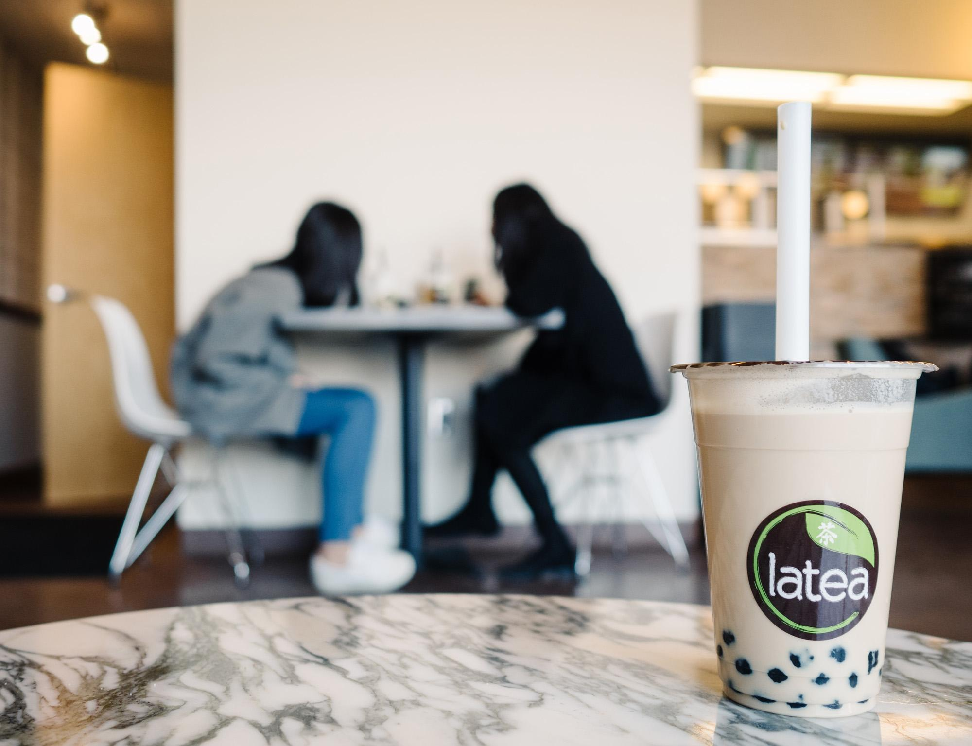 Two girls chat in the new Latea cafe.