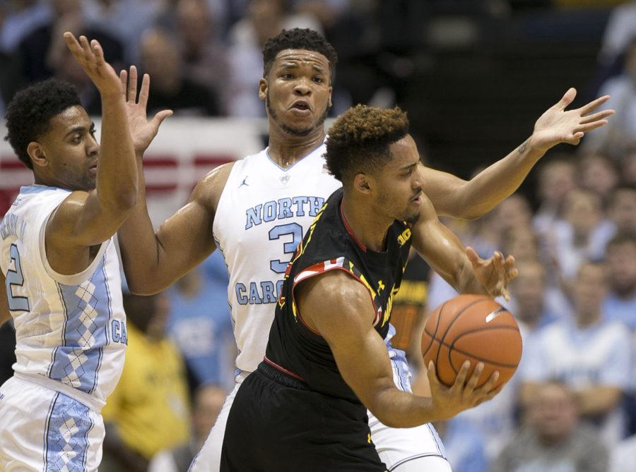 Maryland's Melo Trimble (2) is trapped by North Carolina's Kennedy Meeks (3) and Joel Berry II (2) during the first half on Tuesday, Dec. 1, 2015, at the Smith Center in Chapel Hill, N.C. The host Tar Heels won, 89-81. (Robert Willett/Raleigh News & Observer/TNS)
