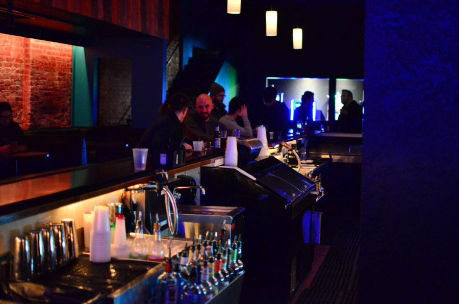 Local+patrons+enjoy+a+drink+at+the+Accord+during+open+mic+night+on+Feb.+23.+