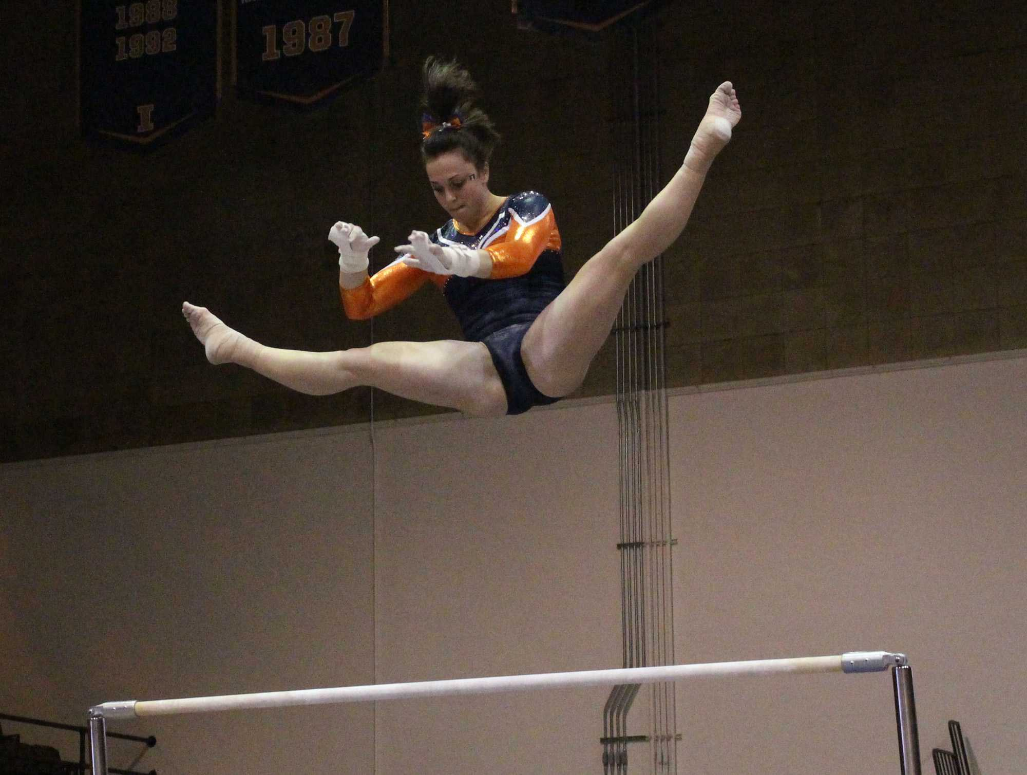 Giana O'Connor on the bars during the match against Michigan at Huff Hall on January 22, 2016. Michigan won 196.825 to 195.15.