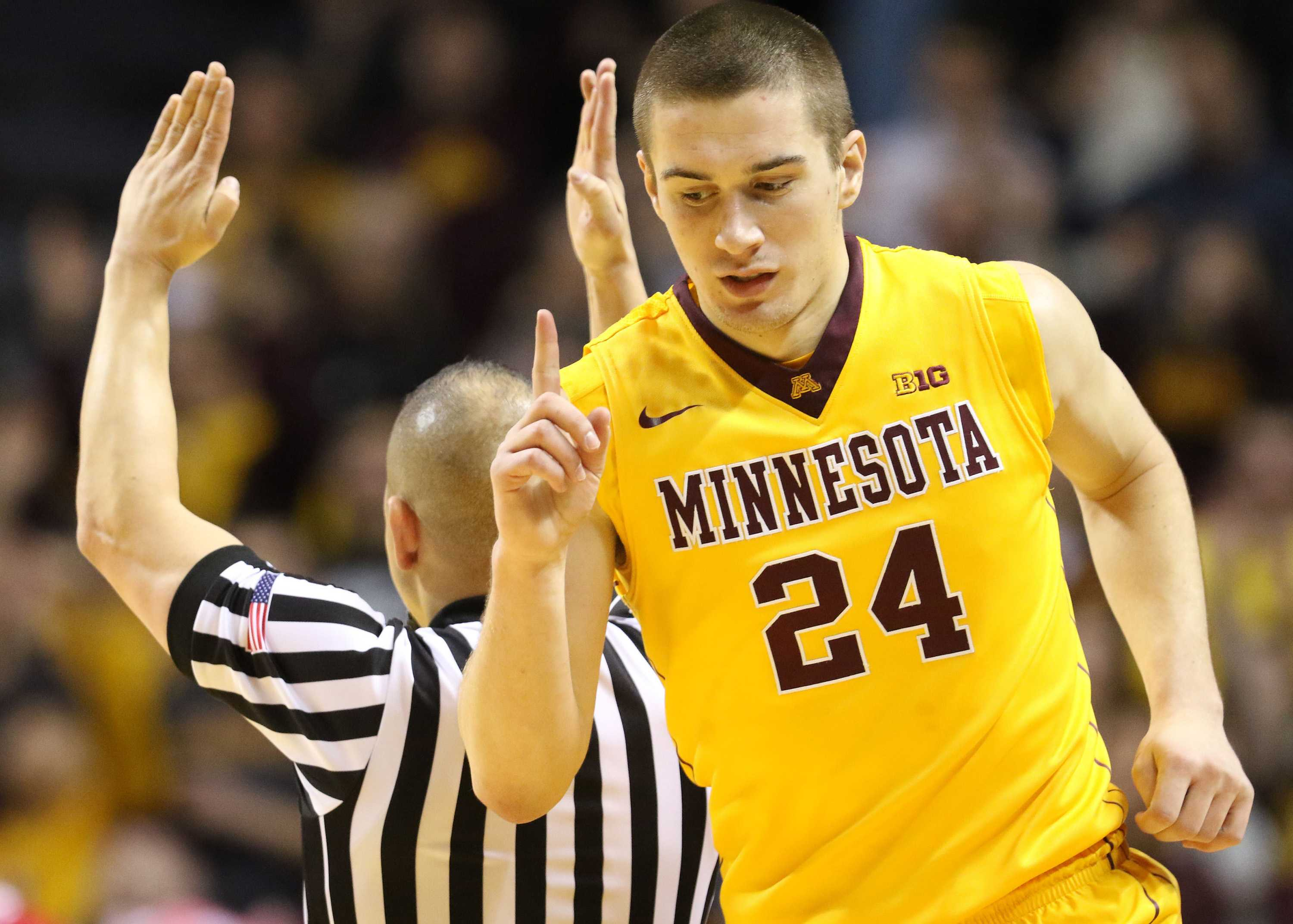 Minnesota's Joey King (24) signals after hitting a 3-point shot during the first half against Indiana on Saturday, Jan. 16, 2016, at Williams Arena in Minneapolis. Indiana won, 70-63. (David Joles/Minneapolis Star Tribune/TNS)