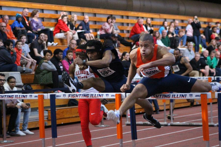 Illinois' Cam Viney jumps over a hurdle in the Orange and Blue meet at the Armory on Saturday, Feb. 20, 2016