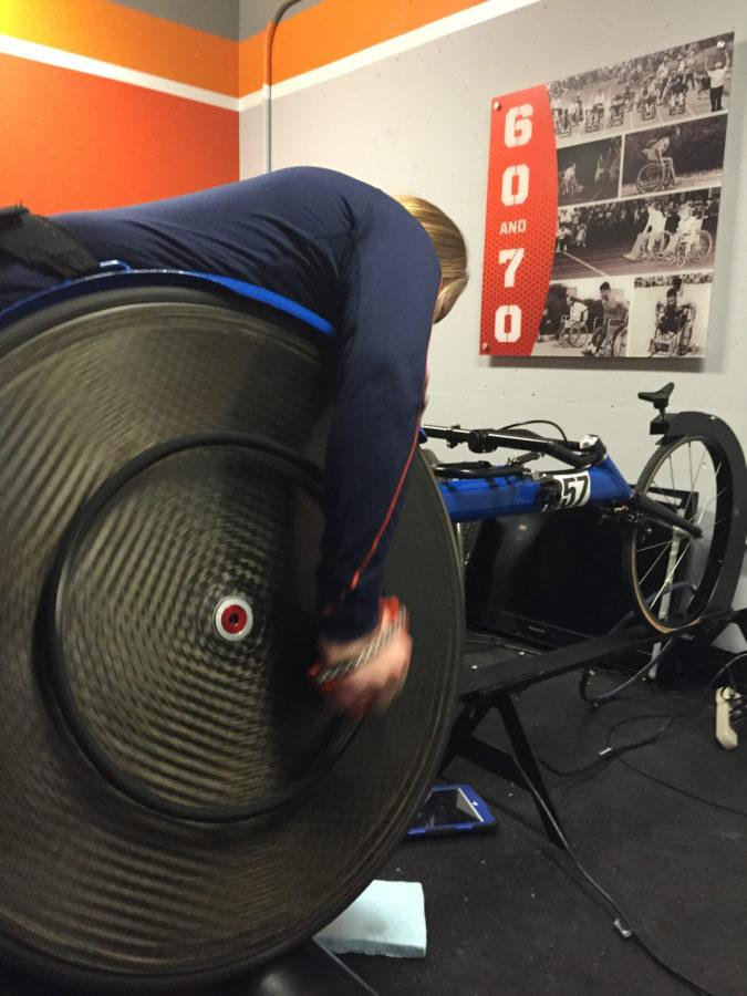 Illinois wheelchair racer Ariel Rausin training with a pair of racing gloves printed by the teams 3-D printer.
