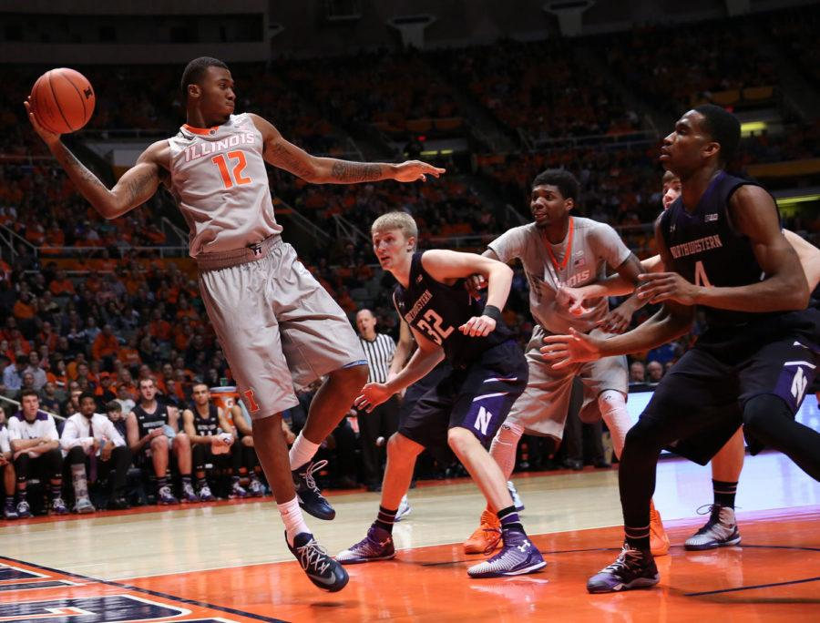 Illinois%27+Leron+Black+%2812%29+attempts+to+save+the+ball+from+going+out+of+bounds+during+the+game+against+Northwestern+at+State+Farm+Center%2C+on+Saturday%2C+Feb.+28%2C+2015.+The+Illini+won+86-60.