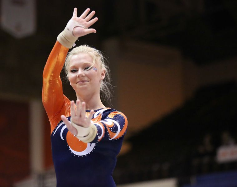 Erin Buchanan preforms her floor exercise routine during the meet against Michigan at Huff Hall on Friday. The Illini lost 195.800-195.575.