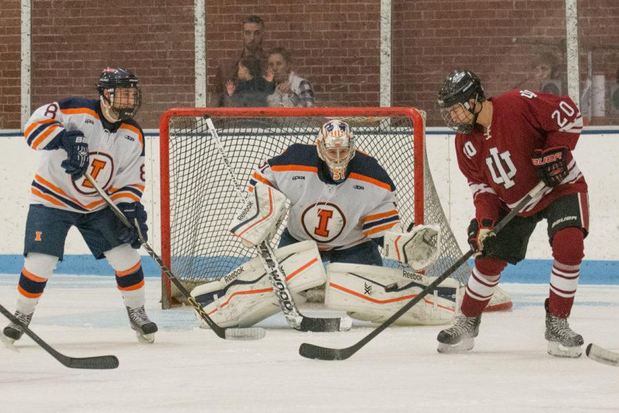 Joe Olen tracks the shot to make a save during the game against Indiana at the Ice Arena on Friday, Nov. 6. Illinois won 5-3.