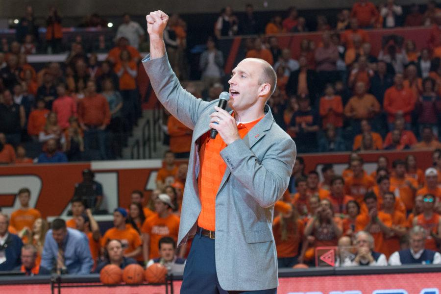 Illinois' new athletic director Josh Whitman lead the State Farm Center crowd in an