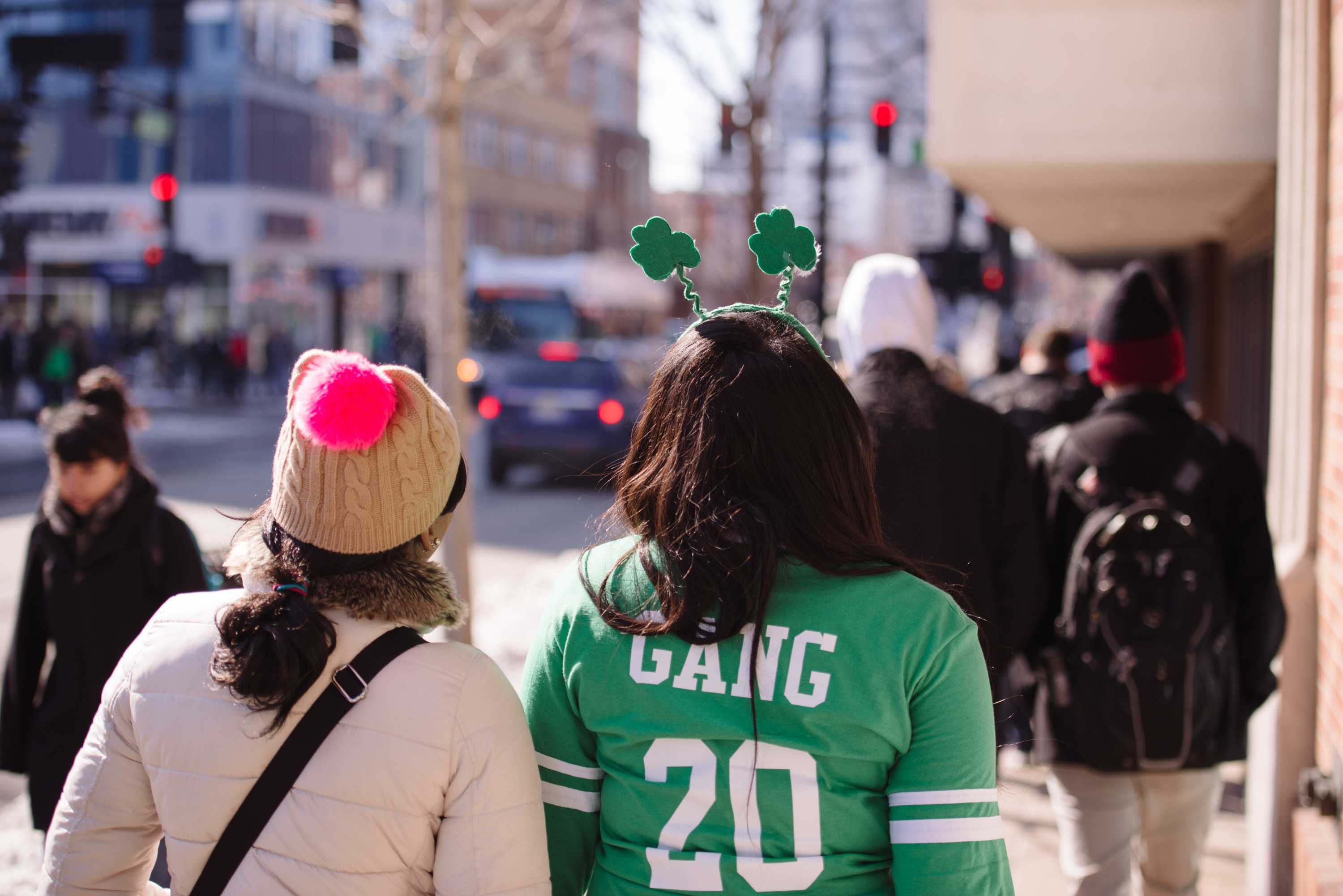Unofficial participants walk down Green Street in search of fun and festivities on last March.
