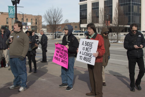 Citizens of the Champaign-Urbana district protest against the non-indictment of Champaign Police Department officer Matt Rush at the Champaign County Courthouse on Friday, Feb. 26, 2016.