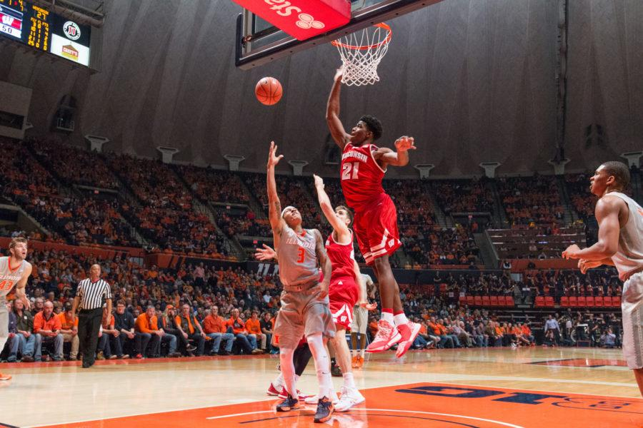 Illinois' Khalid Lewis gets blocked on a layup by Wisconsin's Khalil Iverson during the game against Wisconsin at the State Farm Center on Sunday, January 31. The Illini lost 63-55.