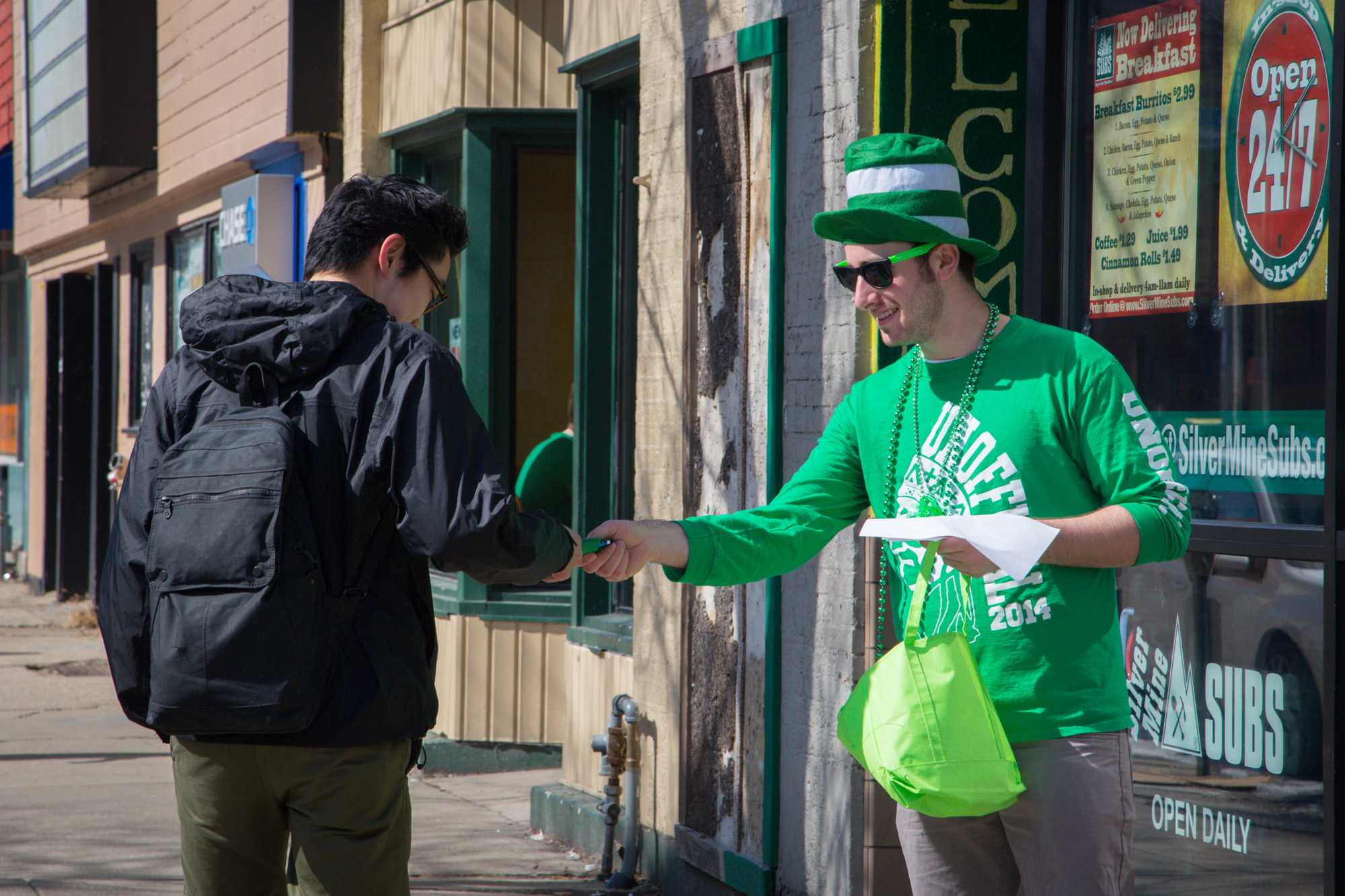 William, a senior in chemical engineering, hands out souvenirs during a pervious Unofficial.