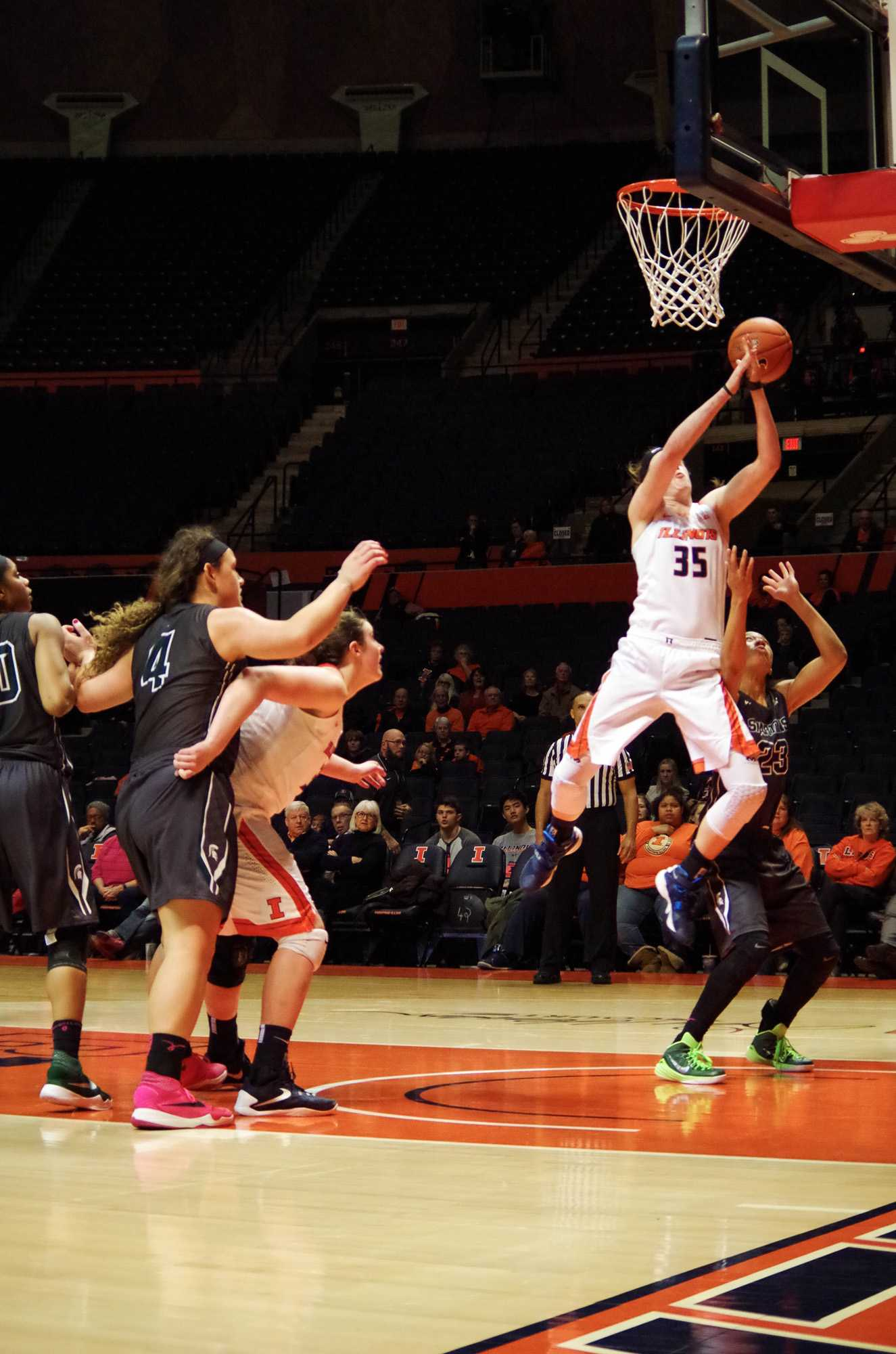 All eyes are on Illinois' Alex Wittinger (35), as she goes up for the layup at the game against Michigan State at State Farm Center on Wednesday, Feb. 24th, 2016. The Illini lost 43-71.