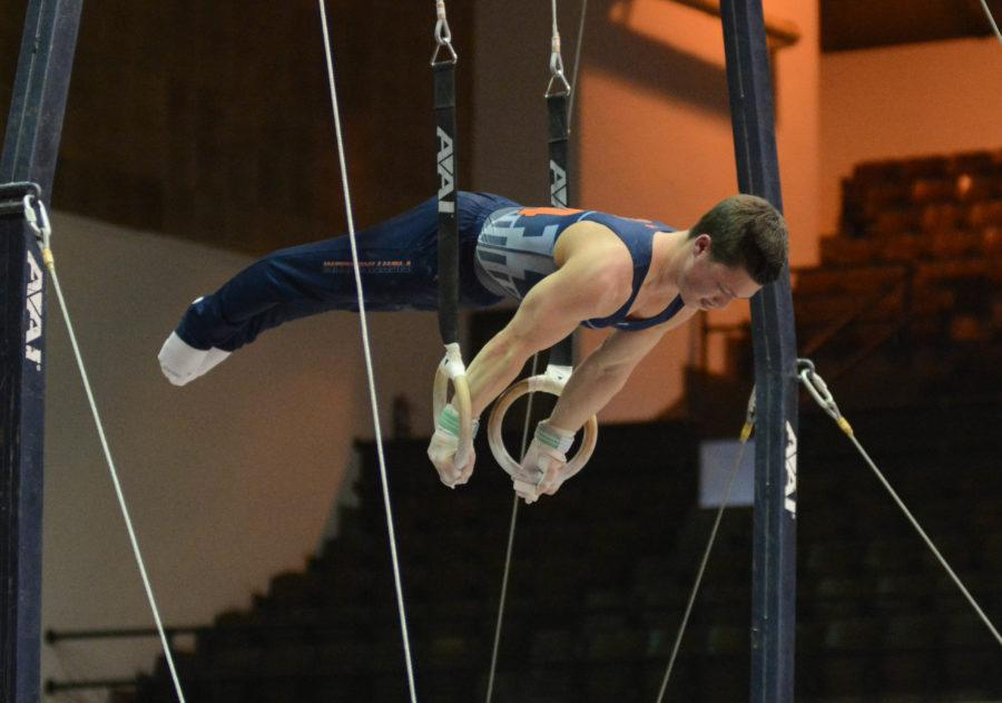Illinois' Alex Diab attempts a dismount during his ring routine in the meet against Temple & UIC at Huff Hall on Saturday, Feb. 6, 2016.