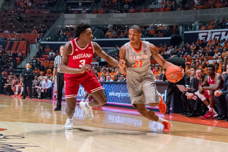 Illinois' Malcolm Hill dribbles around Indiana's OG Anunoby during the game against Indiana at the State Farm Center on February 25. The Illini lost 74-47.