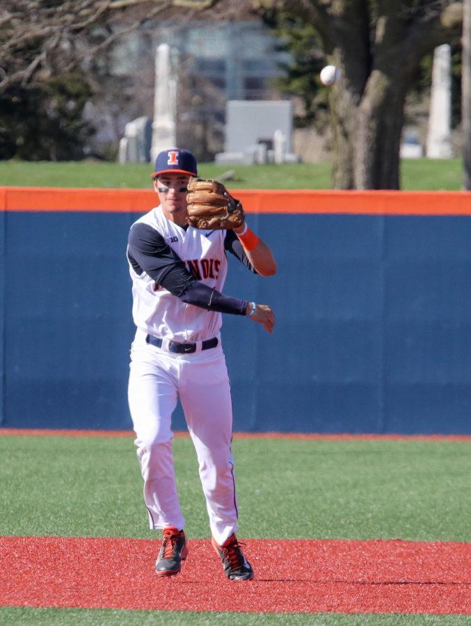 Illinois Adam Walton (6) throws a ball to first base during the baseball game v. Purdue at Illinois Field on Saturday, Apr. 11, 2015. Illinois won 10-5.