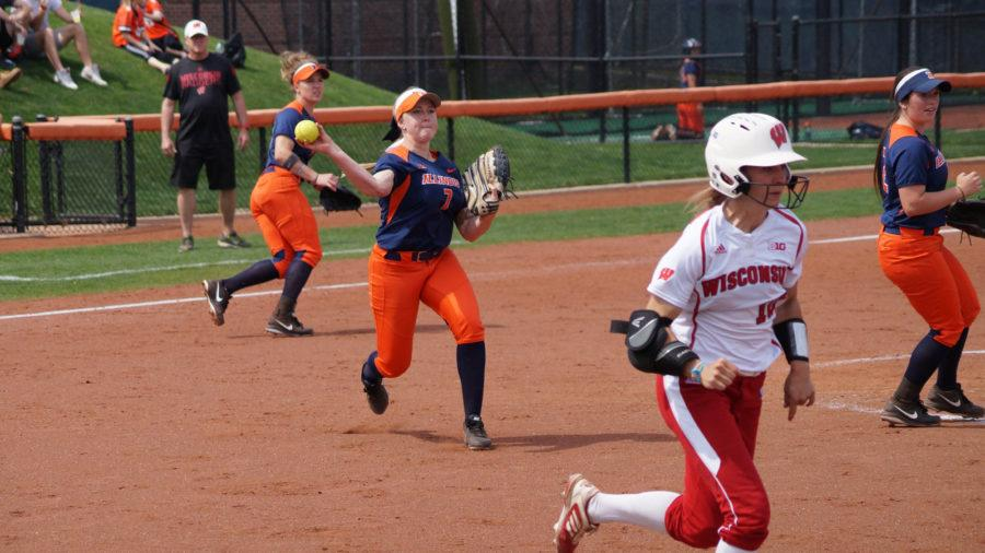 Illinois%27+Jade+Vecvanags+%287%29+throws+the+ball+to+first+base+during+the+softball+game+v.+Wisconsin+at+Eichelberger+Field+on+Saturday%2C+Apr.+18%2C+2015.+Illinois+won+5-3.