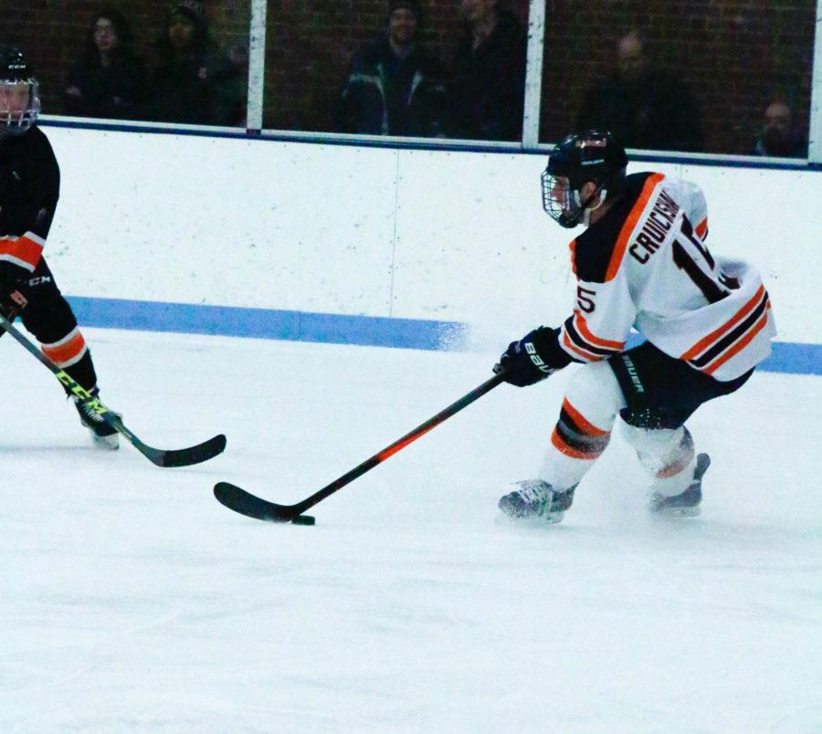 Illinois Eric Cruickshank  defends the puck during the game against Indiana Tech at the UI Ice Arena on Friday, February 27, 2016.