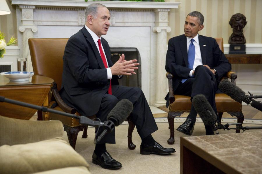 "U.S. President Barack Obama (right) watches as Israeli Prime Minister Benjamin Netanyahu speaks in the Oval Office of the White House in Washington, D.C., on Monday, March 3, 2014. Obama urged Netanyahu to ""seize the moment"" to make peace, saying time is running out to negotiate an Israeli-Palestinian agreement. (Pool photo by Andrew Harrer/Bloomberg via Abaca Press/MCT)"