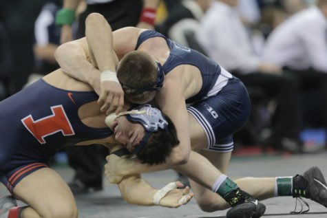 Martinez defeats Nolf to win second straight Big Ten title