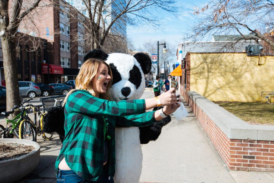 A student takes a selfie with the panda on Unofficial, March 4, 2016.