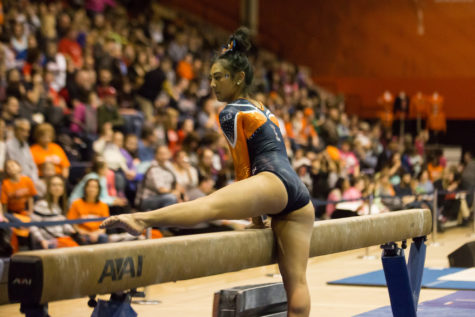 Illinois' Sunny Kato performs a routine on the balance beam during the State of Illinois Classic at Huff Hall on Saturday, March 5, 2015. The Illini claimed victory for the ninth consecutive year with a total of 195.425 over Northern Illinois (194.225), UIC(192.625) and Illinois State (191.500).