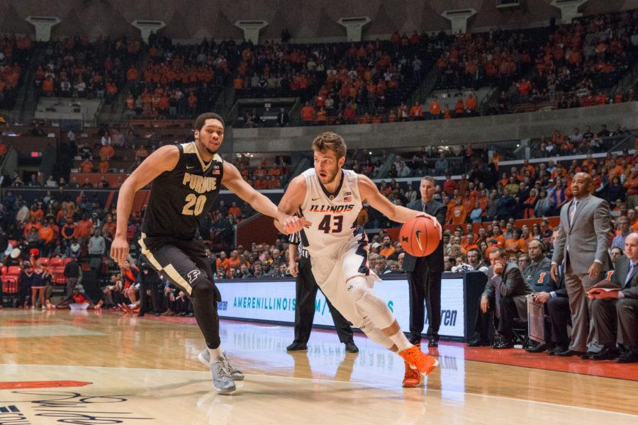 Illinois' Michael Finke drives to the basket during the Illini's 84-70 victory over the Boilermakers at State Farm Center on Sunday, January 10.