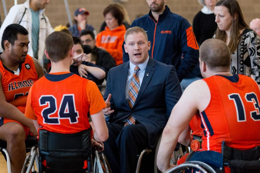 Illinois head coach Matt Buchi talks to his team during a time out in the game against Arizona State University at the Activities and Recreation Center on February 13. The Illini won 69-43.