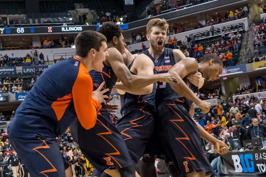 Illinois%27+Michael+Finke+hugs+Maverick+Morgan+and+Malcolm+Hill+after+defeating+Iowa+in+the+second+round+of+the+Big+Ten+Tournament+in+Indianapolis%2C+Indiana+on+March+10.+The+Illini+won+68-66.